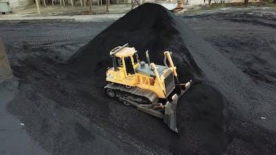 Bulldozer Moves the Coal