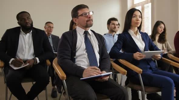Diverse Multi Ethnic Audience Noting at Seminar