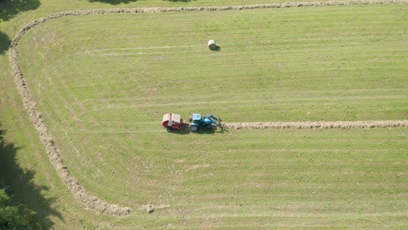 Thumbnail for Blue Tractor Hay Bales Trees Aerial View