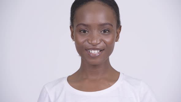 Thumbnail for Face of Young Happy African Woman Smiling Against White Background
