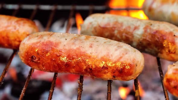 Thumbnail for Delicious Juicy Sausages, Cooked on the Grill with a Fire