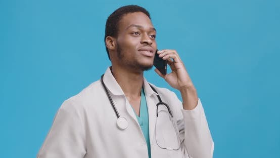 Medical Doctor Consulting Patient Via Phone Talk, Speaking Politely and Friendly, Blue Background