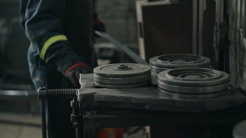Locksmith Bends a Metal Profile Along a Certain Radius on a Bending Machine Metalwork at Blacksmith