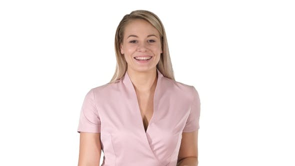 Thumbnail for Beautiful toothy smile of lovely woman in pink on white background.