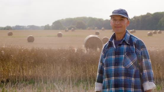 Thumbnail for Farmer Using Digital Tablet at Farm Against Sunset