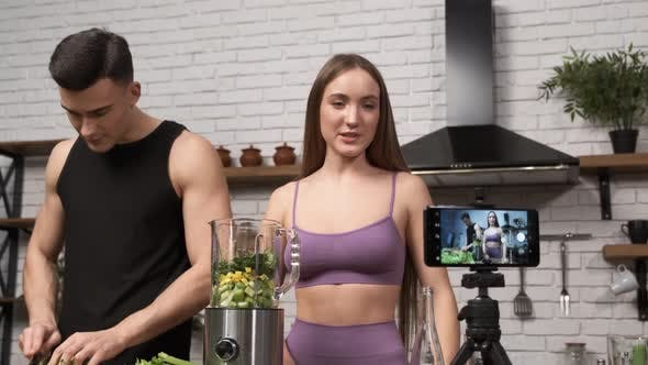 Thumbnail for Food Vlog Attractive Fitness Female and Male Recording a Video About Healthy Eating on Mobile Phone