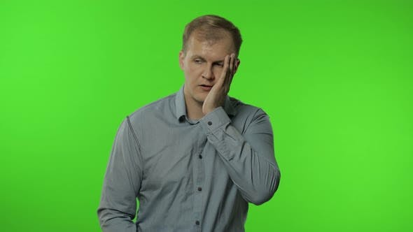Thumbnail for Sleepy Bored Guy Looking at Camera Not Interested in Communication. Man on Chroma Key Background