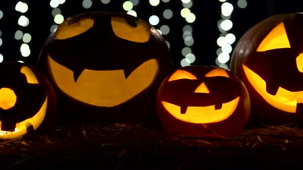Thumbnail for Halloween and Holidays Concept - Spooky Jack-o-lantern or Carved Pumpkin. Close Up. Black Bokhe