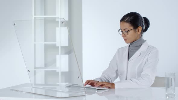 Cover Image for Female Doctor Using PC with Transparent Screen