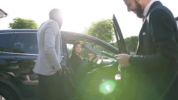 Thumbnail for Female Seller of Prestigious Car Dealership Telling Characteristics