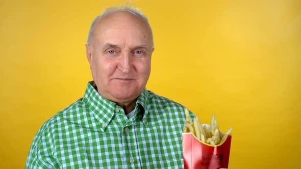 Thumbnail for Senior Man Eating Fries