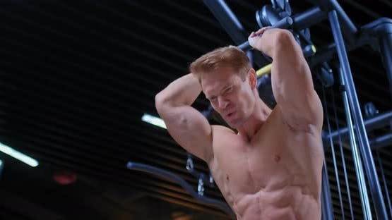 Young Bodybuilder Trains on a Power Rack, Does a Row for the Head, Relief Muscle Body