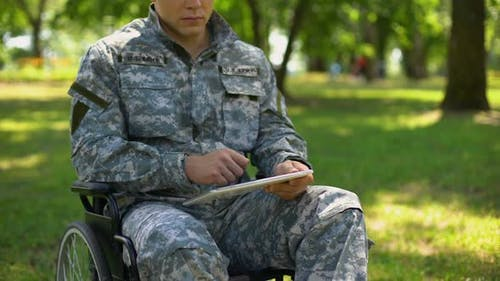 American Serviceman Using Tablet in Wheelchair, Searching Health Care Service