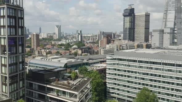 Thumbnail for London Metropolis. Flying in Between Modern Looking Buildings