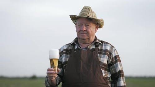 Handsome Old Men Drinking Beer