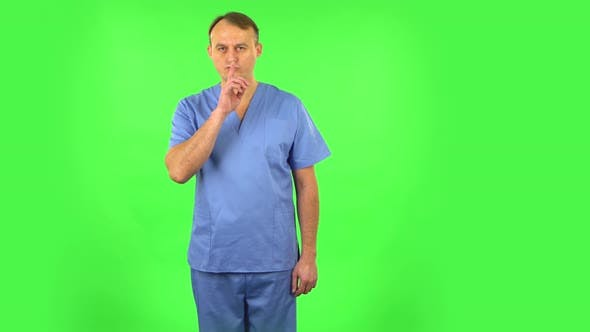 Thumbnail for Medical Man Looks Around, Covers His Mouth with His Hand and Whispers the Secret and Making a Hush