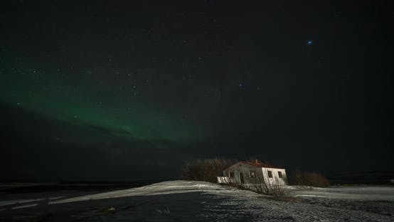 Thumbnail for Timelapse of Aurora Borealis Northern Lights Over Small Building in the Show Field, Iceland