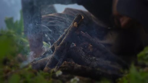 Set Campfire Was Blew By A Man On Misty Morning - Dolly Shot