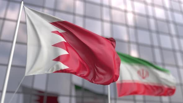 Flags of Bahrain and Iran in Front of a Skyscraper