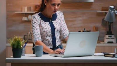 Freelancer Receving Good News on Laptop