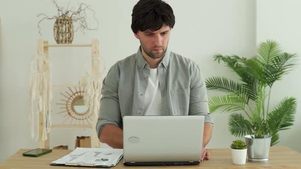 Man Working in Office Using Laptop in Office
