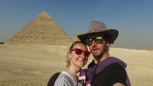 Happy couple in front Giza pyramids
