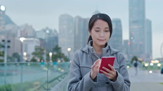 Thumbnail for Woman check on mobile phone