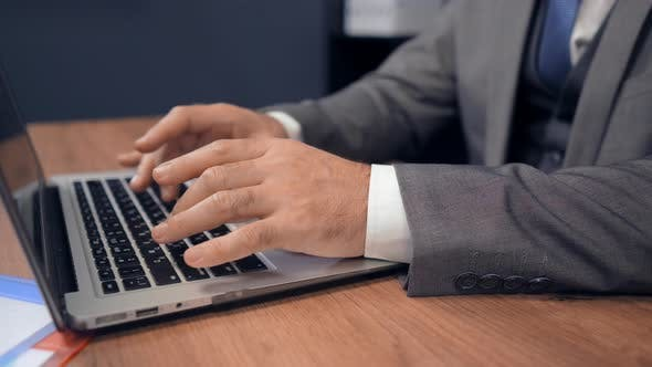 Thumbnail for Close Up Middle Aged Businessman Using Laptop in Office