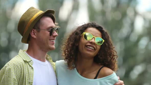 Cover Image for Young Couple Having Great Time at Outdoor Party, Hugging and Dancing Together