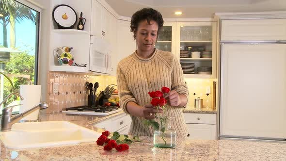 Thumbnail for Woman arranging flowers in the kitchen