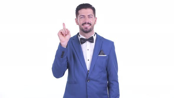 Thumbnail for Happy Young Handsome Bearded Businessman Pointing Up