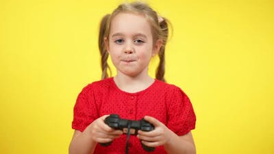 Positive Confident Baby Girl Playing Video Game Using Game Console