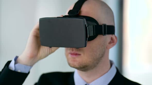 Thumbnail for Businessman with Virtual Reality Headset at Office