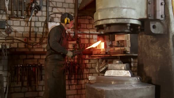 Thumbnail for A Man Blacksmith Heating Up the Knife and Put It Under a Pressure Machine