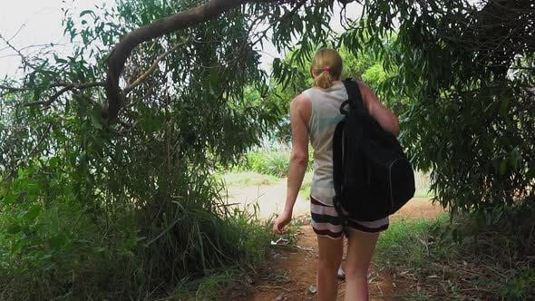Thumbnail for girl tourist with a backpack out of the forest on a tropical island. seascape