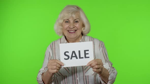 Thumbnail for Elderly Stylish Grandmother Smiling and Holding Sale Word Inscription Banner, Black Friday