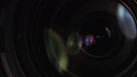 The Front Lens of the Lens is Illuminated By a Beam of Light with Glare