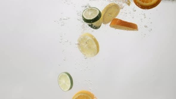 Thumbnail for Orange, Lemon and Lime Slices Falling Into Water with Bubbles on White Background. Сitrus Falling