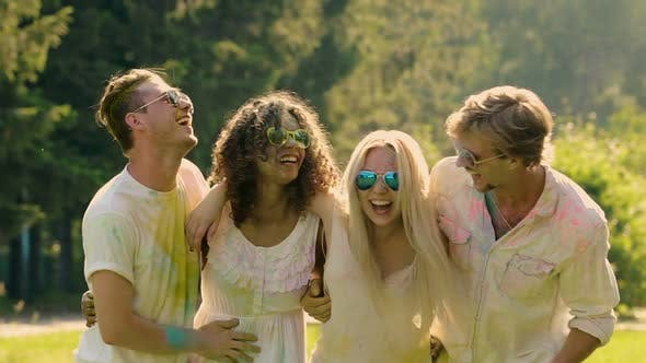 Cover Image for Excited Group of Friends Embracing Outdoors Having Fun at Party in Slow Motion