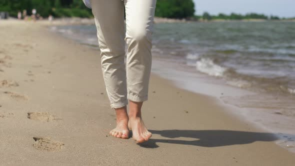 Thumbnail for Woman Feet Walking Barefoot Along Summer Beach 9