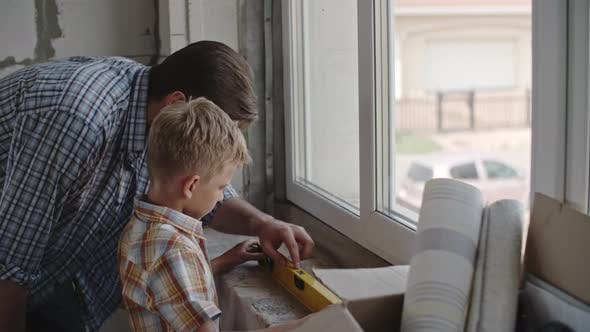 Thumbnail for Little Boy Renovating House with Dad