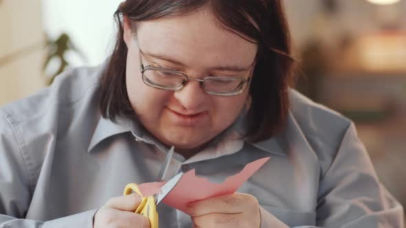 Man with Down Syndrome Doing Paper Crafts