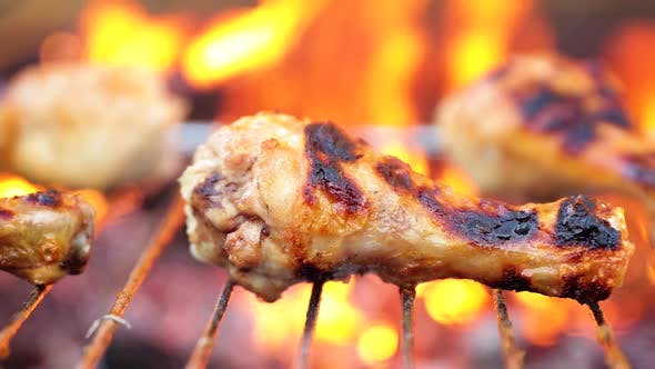 Grilled chicken BBQ cooked with a fire