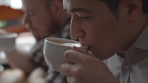 Asian Man Enjoying Coffee