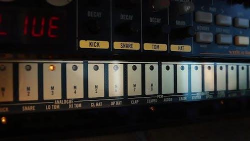 Analog beats synthesizer with rhythmic lights