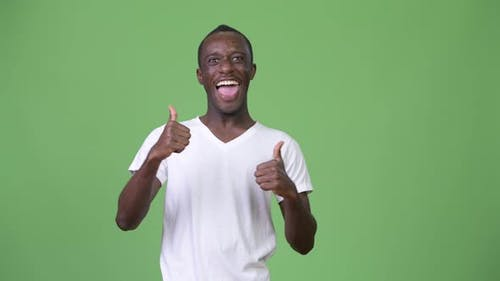 Young Happy African Man Smiling While Giving Thumbs Up