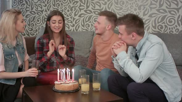 Thumbnail for Attractive Teen Girl Celebrates Her Birthday with Friends at Home and Blows Out the Candles on Cake