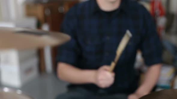Closeup of man playing drums in garage band