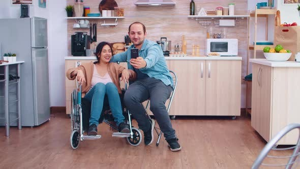 Thumbnail for Positive Woman in Wheelchair and Husband Taking a Selfie