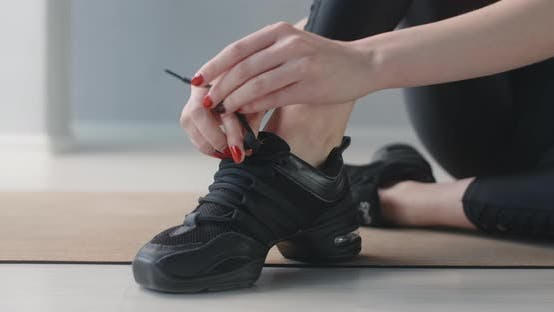 Thumbnail for Woman Ties Shoelaces in the Dance Room Before the Classes, Dancer Prepares for the Show, Woman Gets
